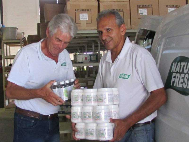Jim and Mahir with health products